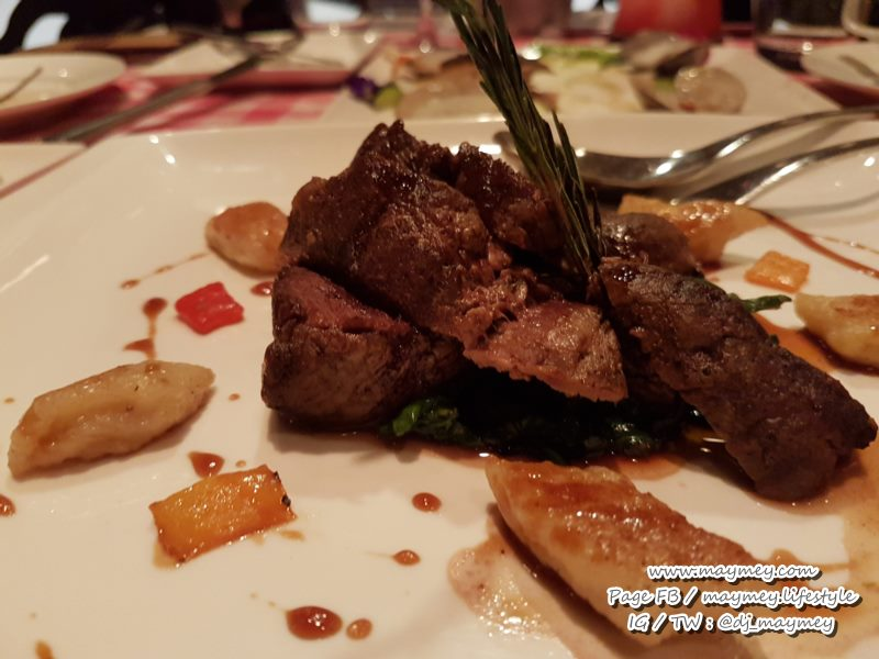 Beef fillet with fresh herbs, spinach and potato gnocchi