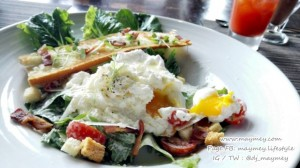 Romaine lettuce tossed with Caesar dressing and mornay sauce, shaved parmesan, croutons topped with poached egg